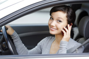 woman-in-car-with-cell-phone-